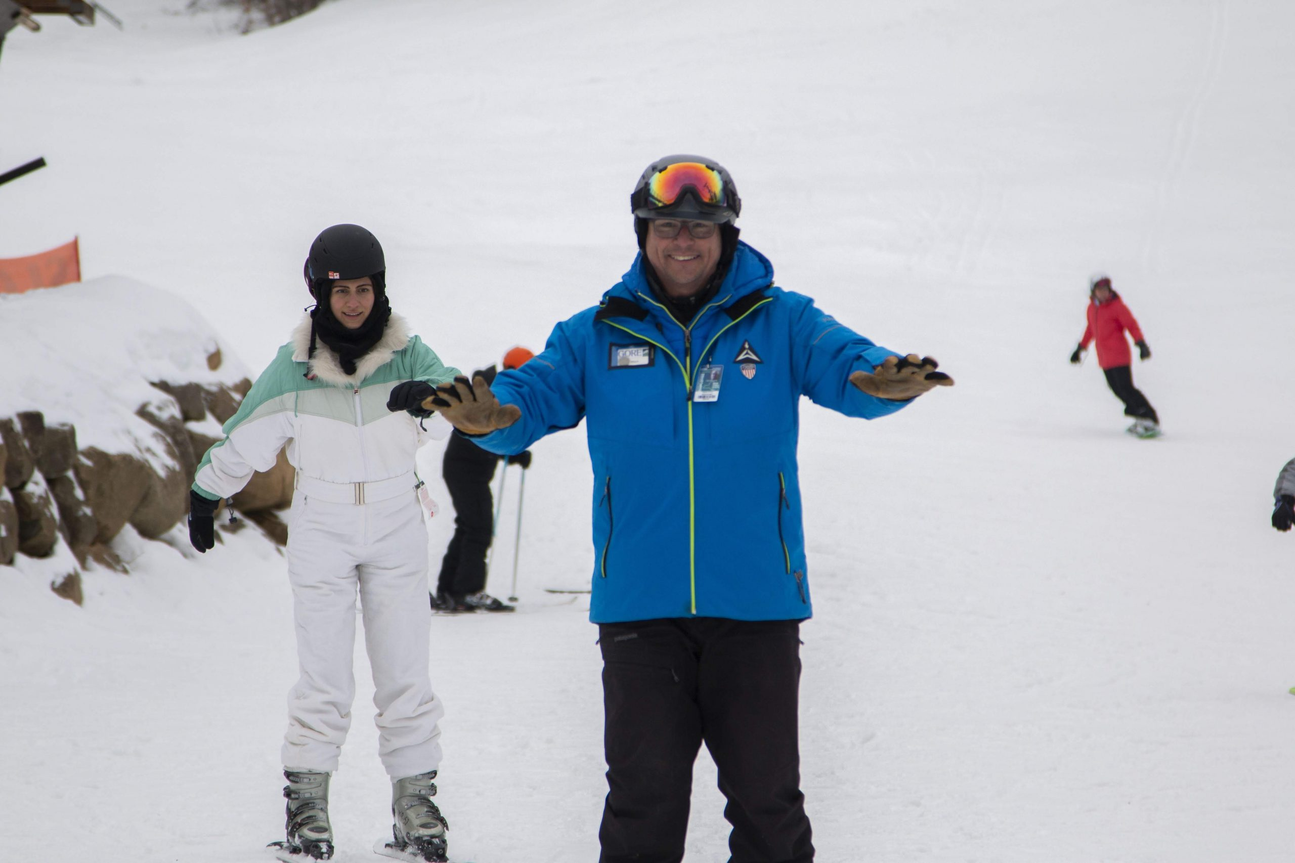 Adult Woman Learning how to ski for the first time with an Instructor