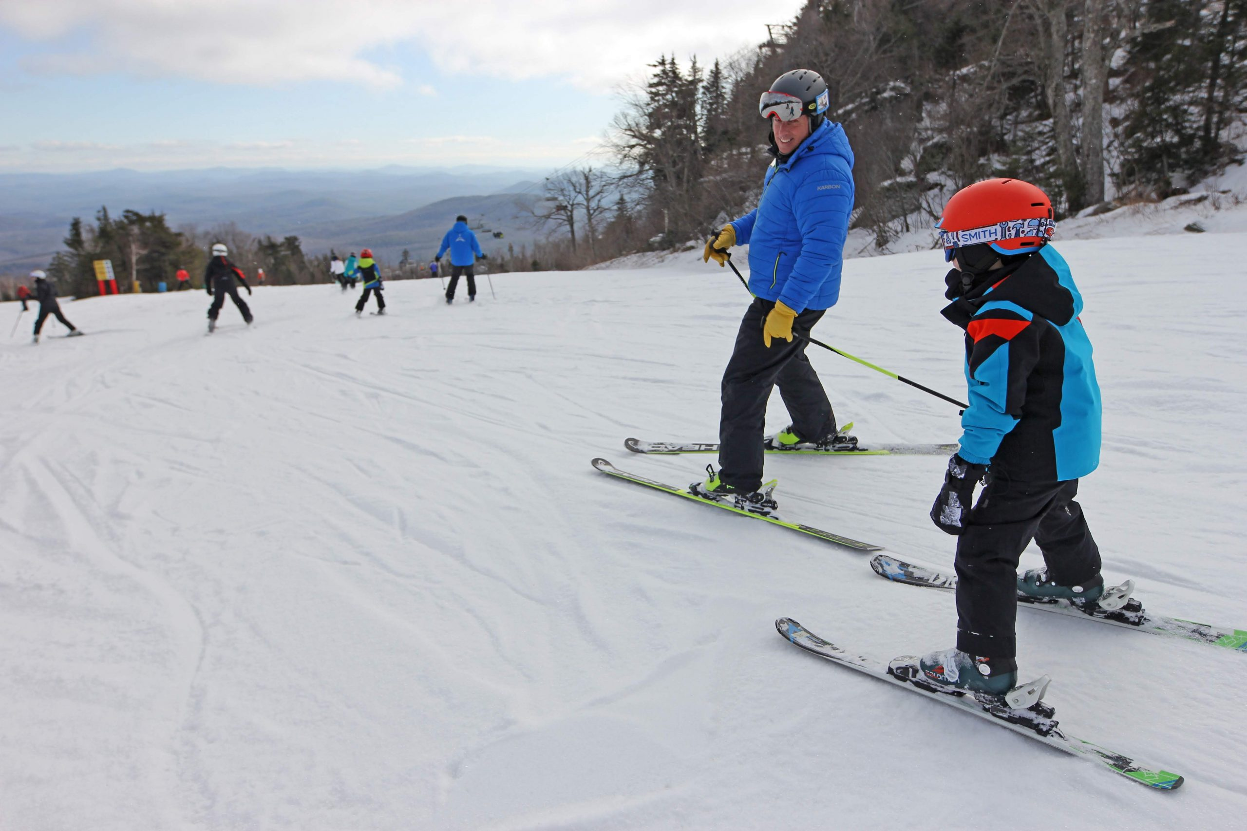 Kid in a lesson skiing