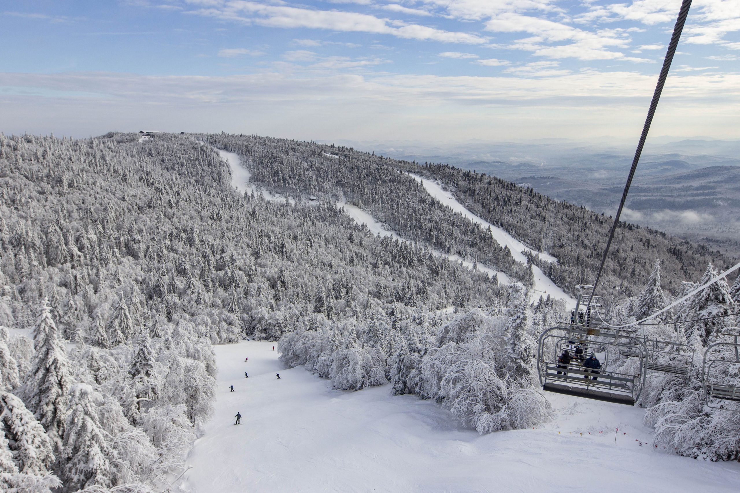view of a chairlift and ski trails in winter