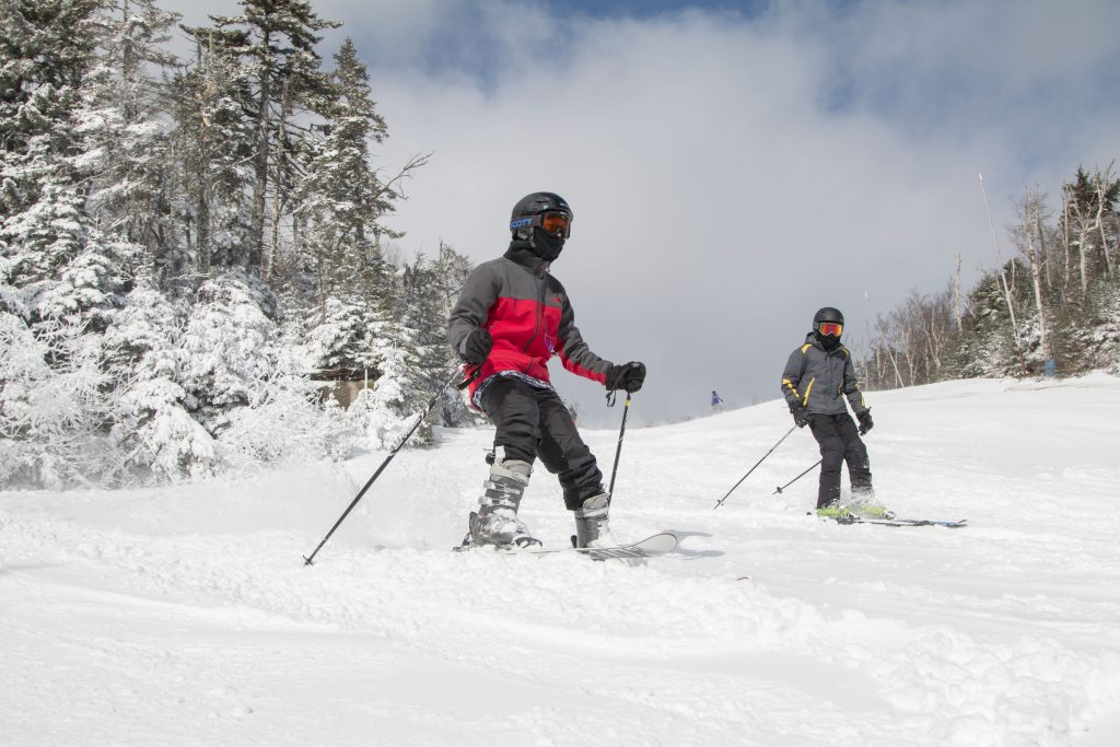 Two young boys skiing