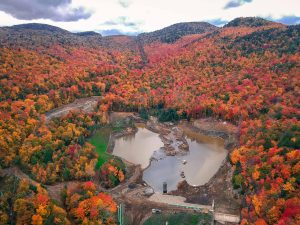 Aerial view of reservoir in fall leaves