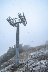 Newly installed lift towers in the snow