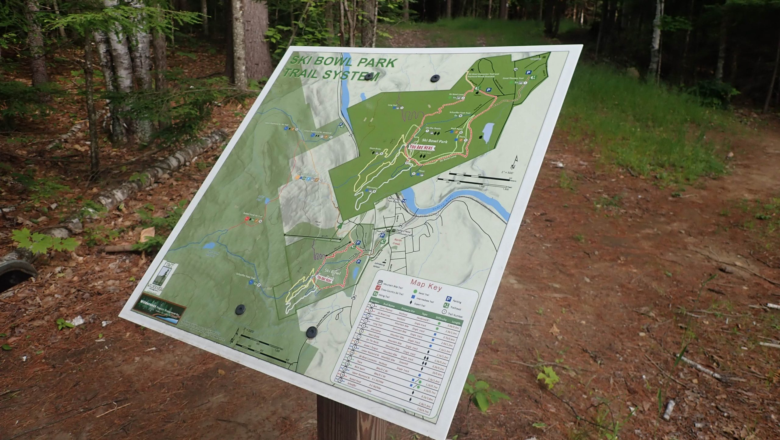 photo of Ski Bowl Park Trail System map in woods