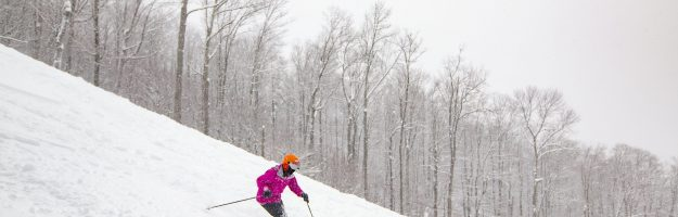 a lady skiing a trail